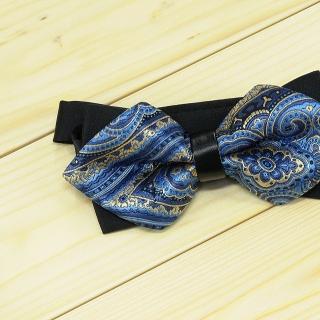 Недорогая модная галстук-бабочка черного цвета из плотной хлопковой ткани с узором в виде огурцов.