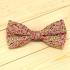 Недорогая цветочная галстук-бабочка на застежке с яркими вставками. thumb